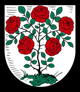Wappen der Stadt Annaburg. Ein Rosenstock mit fünf roten Blüten